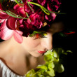 Beautiful young girl with creative floral accessories — Stock Photo