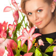 Portrait of young beautiful woman with flowers — Stock Photo