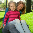 Royalty-Free Stock Photo: Mother and daughter are sitting at the park