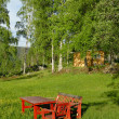 Foto Stock: Red wooden table and chairs
