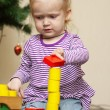 Little girl playng with toy blocks - Stock Photo