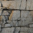 Deeply cracked granite surface texture — Stock Photo #4274282