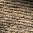 Grooved asphalt or rock surface texture  lit diagonally — Stock Photo