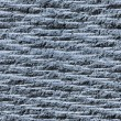Grooved asphalt or rock surface texture seamlessly tileable with — Stock Photo