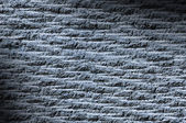 Grooved asphalt or rock surface texture lit diagonally with blue — Stock Photo