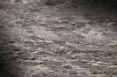 Textura de superfície de rocha rachada aceso na diagonal — Fotografia Stock
