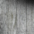 Stock Photo: Weathered gray wooden barn siding lit diagonally