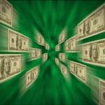 100 bills flying through a green vortex — Stock Photo #5076168