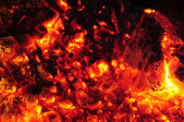 Burning embers in a molten fire — Stock Photo