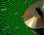 Stack of CD/DVD disks against a curved field of binary code — Stockfoto