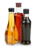 Bottles with apple and red wine vinegar and soy sauce — Stock Photo
