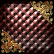 Golden ornament on leather — 图库照片
