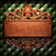 Red wood ornament on leather — Stock Photo
