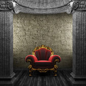 Stone columns and chair — Stock Photo