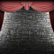 Red velvet curtain and stone wall — Stockfoto