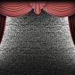Red velvet curtain and stone wall - Stock Photo