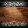 Iron ornament on wood - Stock Vector