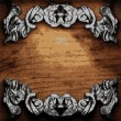 Iron ornament on wood — Stock Vector