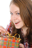 Pretty girl holding presents — Stock Photo