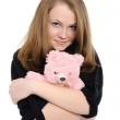Beautiful girl embraces teddy bear — Stock Photo #4625510