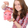 Photo: Young womwith piggy bank