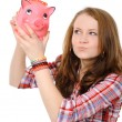 Stock Photo: Young womwith piggy bank
