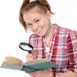 Stock Photo: Eye and magnifying glass and book