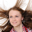Girl with hair fluttering in the wind — Stock Photo