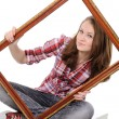 Woman holding an old picture frame over — Stock Photo