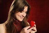 Beautiful woman with a heart gift — Stock Photo