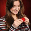 Stock Photo: Woman with a heart gift