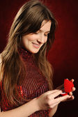 Woman with a heart gift — Stock Photo
