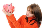 Young woman standing with piggy bank — Stock Photo