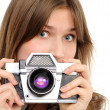 Stock Photo: Womtaking photo with vintage camera