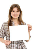 Woman holding empty white board — 图库照片