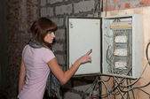 Young girl with electric switches — Stock Photo