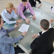 Stock Photo: Group of business at meeting