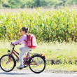 Schoolgirl traveling to school on bicycle - Stockfoto