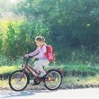Schoolgirl traveling to school on bicycle - 图库照片