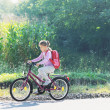 Schoolgirl traveling to school on bicycle - Foto Stock