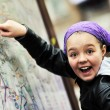 Girl with city map panel — Stockfoto