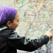 Girl with city map panel — Stock Photo