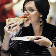 Woman eat pizza food at restaurant — Stock Photo