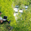 Stock Photo: Man outdoor laptop