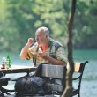 Senior man eat desser at outdoor restaurant — Stock Photo #5378501