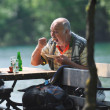 Senior man eat desser at outdoor restaurant — Stock Photo #5378505