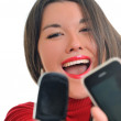 Young woman talk on cellphone — Stock Photo