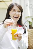 Woman drink juice outdoor — Stock Photo