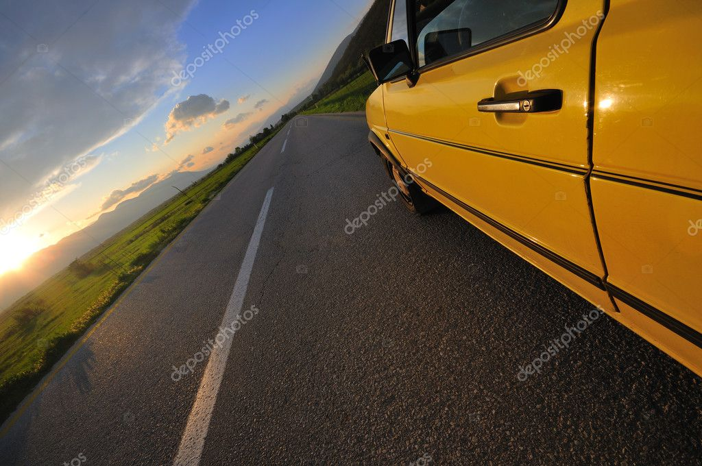 Car on the road at beautiful sunset   Stock Photo #5375886