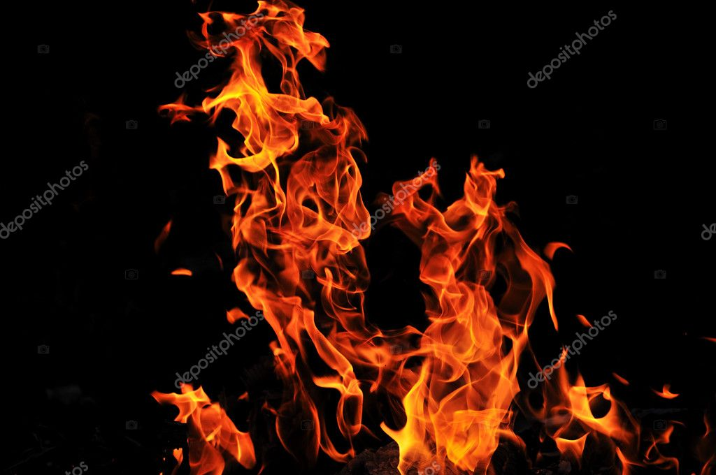 Wild fire flames burn hot with black background — Stock Photo #5377480